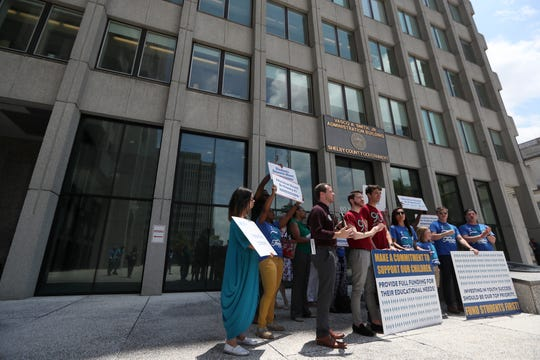 Educators and community leaders gather outside of the Shelby County Administration Building downtown for a 'Fund Students First Public Rally' with budget requests for school facility investments, pre-k funding and other academic initiatives, while county commissioners meet to discuss Shelby County School's budget on Wednesday, June 19, 2019.
