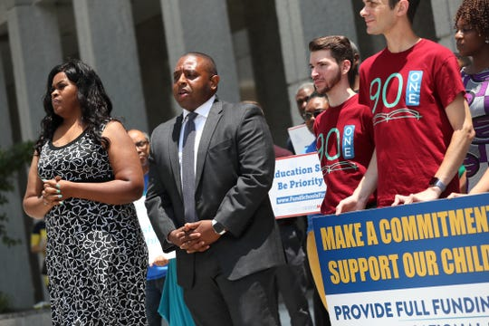 Shelby County School Board members Stephanie Love, left, and Kevin Woods speak in front of educators and community leaders as they gather outside of the Shelby County Administration Building downtown for a 'Fund Students First Public Rally' with budget requests for school facility investments, pre-k funding and other academic initiatives, while county commissioners meet to discuss Shelby County School's budget on Wednesday, June 19, 2019.