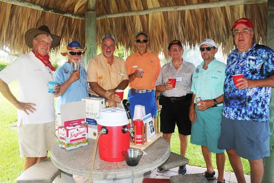 Quenching their thirst are Dave Walsh, Ed Crane, Rusty Roe, Mick Halderman, Dennis Faruol, Vic Ordejia and Jack Williams.