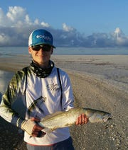Jordan Windle with a big Trout he caught on Tigertail Beach, Marco Island.