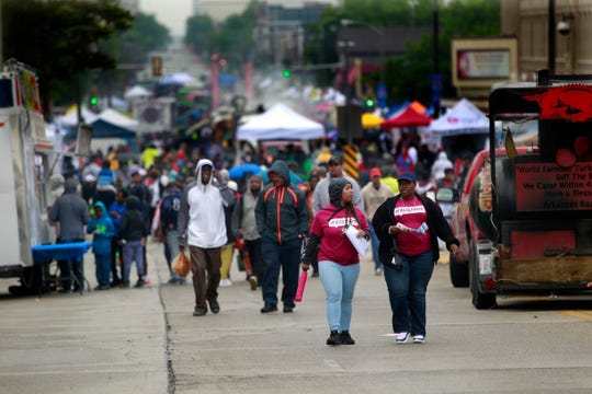 Despite rain and cold weather, hundreds of residents gathered on King Drive to commemorate Juneteenth Day on Wednesday. The streets were flanked by community groups and vendors.