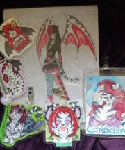 These are pieces of art Monika Lagiewka of Greendale has purchased of her fursona, Cordelia, a tiger dragon.