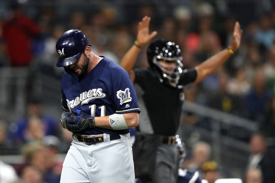 Mike Moustakas  reacts to being hit by a pitch during the fifth inning Tuesday night in the Brewers 4-1 loss to the San Diego Padres.