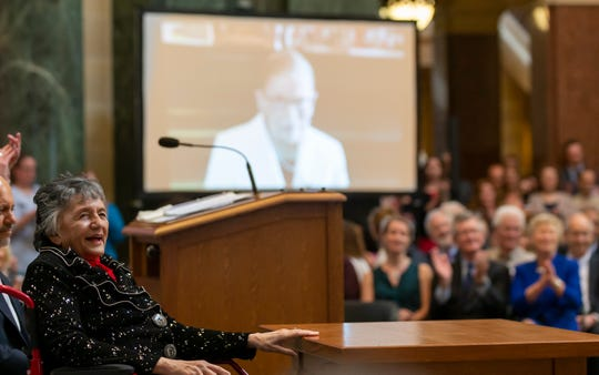 Wisconsin Supreme Court Justice Shirley Abrahamson reacts to a video tribute from U.S. Supreme Court Justice Ruth Bader Ginsburg during a celebration to honor Abrahamson on her retirement from the court.