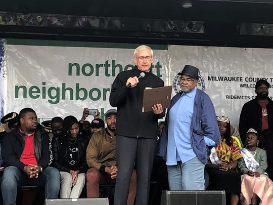 "Wisconsin Gov. Tony Evers presents Northcott Neighborhood House Executive Director McArthur ""Mac"" Weddle with a special commendation. Weddle is retiring from Northcott this weekend after 42 years."