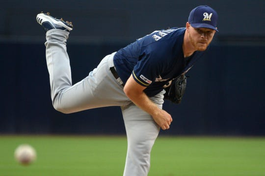 Brewers starter Brandon Woodruff have up two runs in the fifth inning and two runs in the sixth after throwing four scoreless frames Tuesday night.