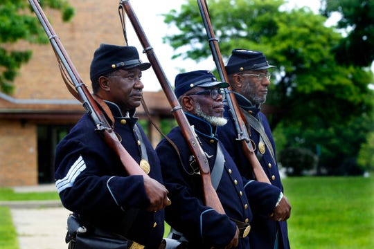 Members from the 29th Infantry Regiment Company F Wisconsin African American Civil War Troop march in the parade.