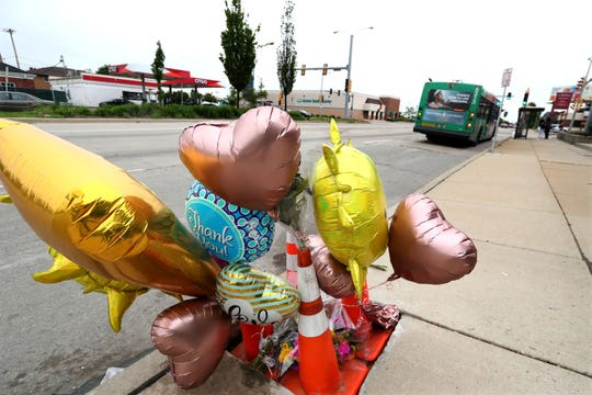 A curbside memorial honors Milwaukee Police Officer Kou Her, who was killed by an alleged drunk driver on his way home from work.  It's at North 60th Street and West Capitol Drive in Milwaukee, looking east  along Capitol.