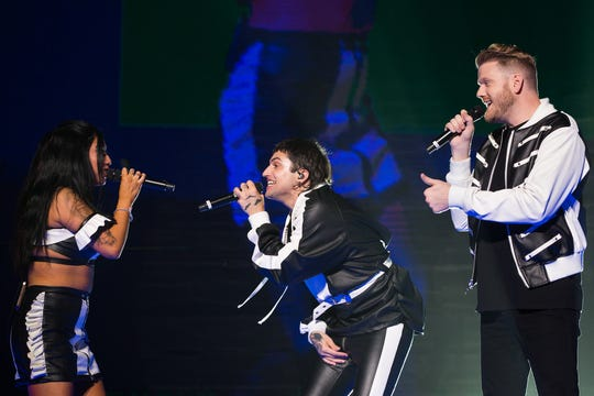 Kirstin Maldonado (from left), Mitch Grassi and Scott Hoying sing to each other during their performance at Fiserv Forum in Milwaukee on Tuesday.