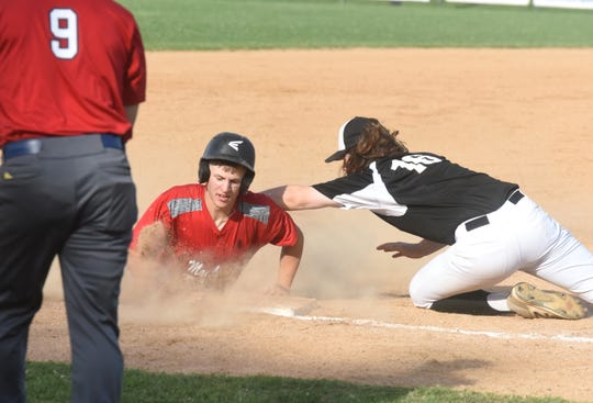 MacLeod's Cade Lewis slides safely into third with a triple against Searcy on Tuesday night at Cooper Park.