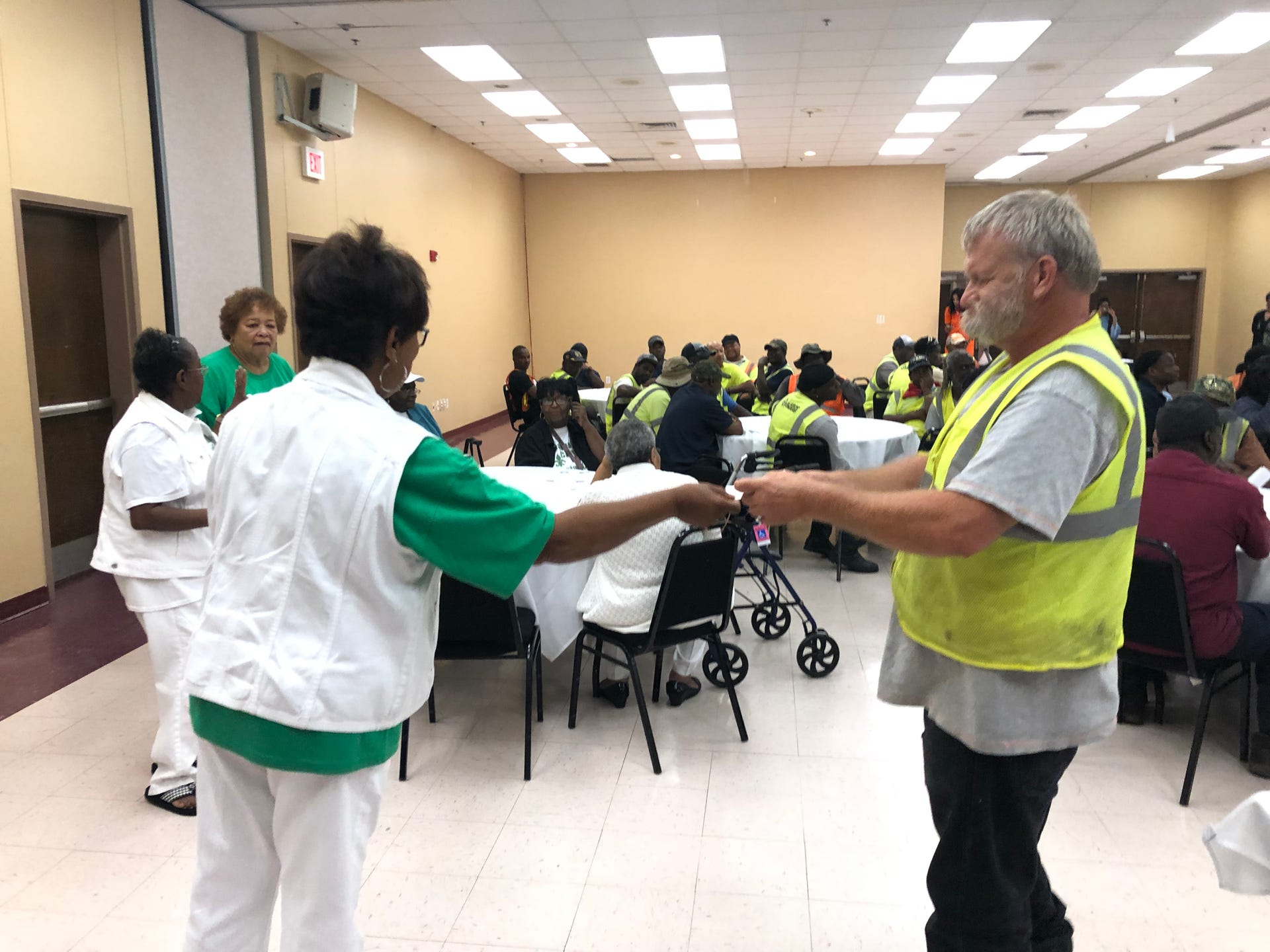 Monroe Sanitation Workers were awarded door prizes provided by local businesses at an event sponsored by the Samoan Civic & Social Club and Allen Green Williamson LLP for National Garbage Man Day. Awards were also distributed at the event.