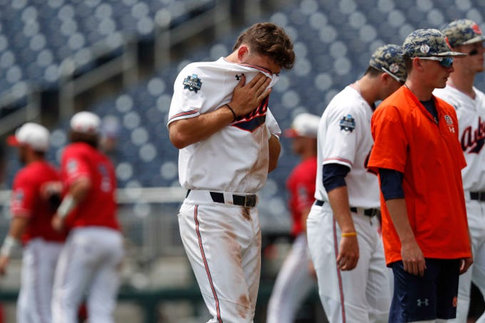 Jun 19, 2019; Omaha, NE, USA; Auburn Tigers third baseman Edouard Julien (10) reacts after losing to the Louisville Cardinals in the 2019 College World Series at TD Ameritrade Park. Mandatory Credit: Bruce Thorson-USA TODAY Sports