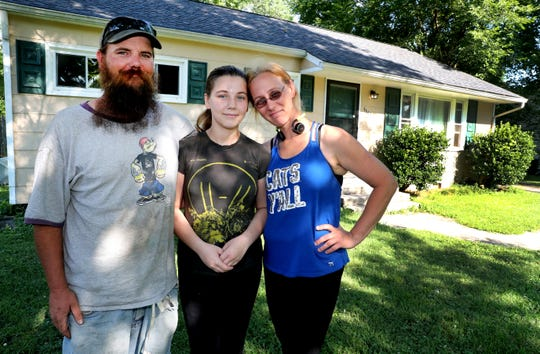 Jacob Ray, left, stands with his family daughter Audrey Ray, 15, center and wife Emily Ray, right, in front of their Murfreesboro home on Wednesday, June 19, 2019. The recent tax increase will raise Ray's property tax greatly.