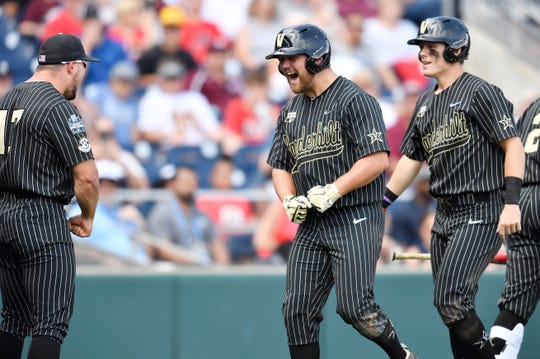 Vanderbilt left fielder Stephen Scott (19) celebrates his three-run homer in the fifth inning to make the score 6-0 over Mississippi State in the 2019 NCAA Men's College World Series at TD Ameritrade Park Wednesday, June 19, 2019, in Omaha, Neb.