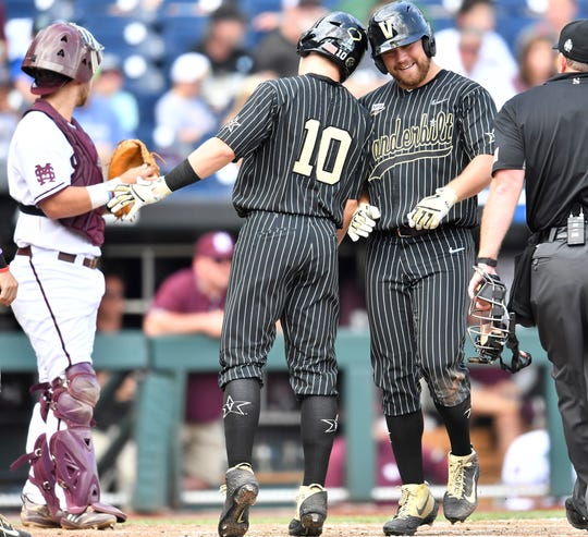 Vanderbilt shortstop Ethan Paul (10) head butts left fielder Stephen Scott (19) after Scott's three-run homer in the fifth inning against Mississippi State in the 2019 NCAA Men's College World Series at TD Ameritrade Park Wednesday, June 19, 2019, in Omaha, Neb.