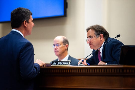 Jim Shulman speaks to Bob Mendes during the Metro Council meeting at the David Scobey Council Chamber Tuesday, June 18, 2019, in Nashville, Tenn.