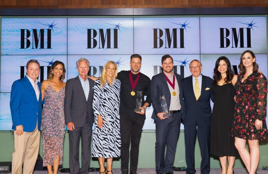 From left: BMI's Jody Williams, Be Essential Songs' Holly Zabka and Terry Hemmings, BMI's Leslie Roberts, 2019 Song of the Year songwriter Ran Jackson, 2019 Songwriter of the Year Ethan Hulse, 2019 BMI Compass Award honoree Elwyn Raymer, Be Essential Songs' Jamie Rodgers and BMI's MaryAnn Keen
