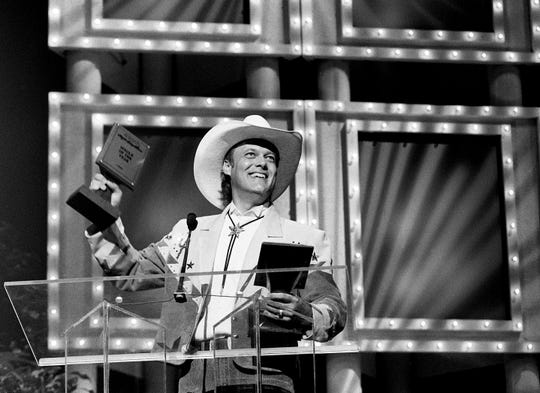 Traditional country singer Ricky Van Shelton thanks the fans after winning the Single of the Year award to go along with his Album of the Year award during the 23rd Music City News Awards show at the Grand Ole Opry June 5, 1989.