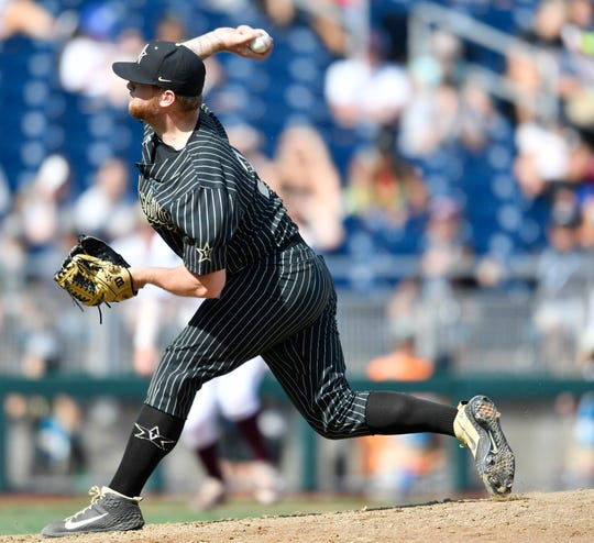Vanderbilt pitcher Tyler Brown (21) pitches in relief in the bottom of the seventh inning during the game against Mississippi State in the 2019 NCAA Men's College World Series at TD Ameritrade Park Wednesday, June 19, 2019, in Omaha, Neb.