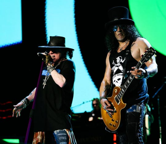 Axl Rose and Slash perform during a recent Guns N' Roses concert at Nissan Stadium in Nashville, Tennessee.