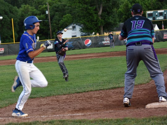 15U Voodoo second baseman Dylan Andrews attempts to get the out at first to teammate Trace Ford during Tuesday night's game against the Gahanna Lions at Don Edwards. The Voodoo defeated the Lions 13-7 on Tuesday, June 18, 2019.