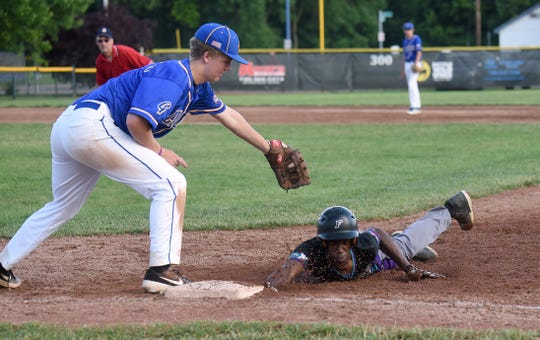 15U Voodoo baserunner Jaden Griffen dives back to first base on a pickoff attempt. The Voodoo defeated the Gahanna Lions 13-7 on Tuesday, June 18, 2019.