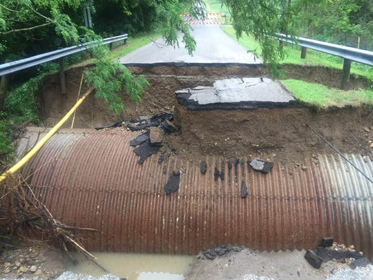 Flash flooding washed away Deeds Road Wednesday morning at a culvert less than a mile west of Ohio 37 in Union Township.