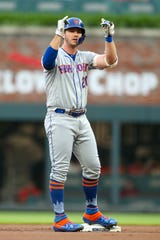 Jun 18, 2019; Atlanta, GA, USA; New York Mets first baseman Pete Alonso (20) gestures after a double against the Atlanta Braves in the first inning at SunTrust Park.