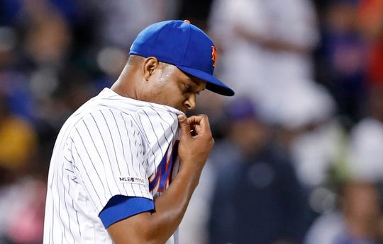 New York Mets relief pitcher Jeurys Familia reacts after allowing a three-run home run to St. Louis Cardinals' Dexter Fowler during the eighth inning of a baseball game Friday, June 14, 2019, in New York.