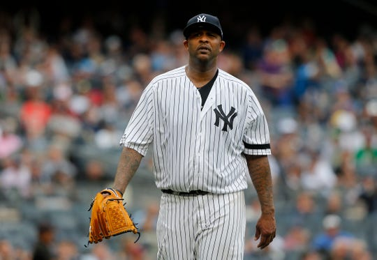 CC Sabathia of the New York Yankees walks to the dugout after the fifth inning against the Tampa Bay Rays at Yankee Stadium on June 19, 2019 in New York City.