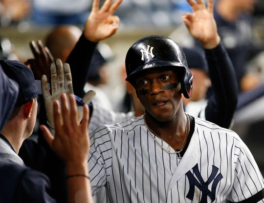 Jun 18, 2019; Bronx, NY, USA; New York Yankees left fielder Cameron Maybin (38) is congratulated in the dugout after hitting a solo home run against the Tampa Bay Rays during the seventh inning at Yankee Stadium. Mandatory Credit: Andy Marlin-USA TODAY Sports