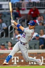 Mets right fielder Michael Conforto (30) hits a RBI double against the Atlanta Braves in the third inning on Jun 18, 2019 in Atlanta, GA.