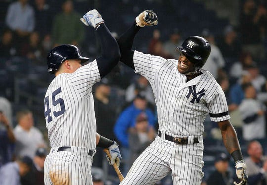 Jun 18, 2019; Bronx, NY, USA; New York Yankees left fielder Cameron Maybin (38) is congratulated by New York Yankees first baseman Luke Voit (45) after hitting a solo home run against the Tampa Bay Rays during the seventh inning at Yankee Stadium. Mandatory Credit: Andy Marlin-USA TODAY Sports