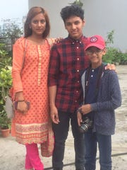 Evana Akter, 21,  and her brothers, Emon Faiman, 16, and Arik, 12, in Bangladesh.