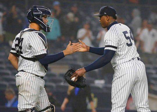 Jun 18, 2019; Bronx, NY, USA; New York Yankees relief pitcher Aroldis Chapman (54) and catcher Gary Sanchez (24) react after defeating the Tampa Bay Rays at Yankee Stadium. Mandatory Credit: Andy Marlin-USA TODAY Sports
