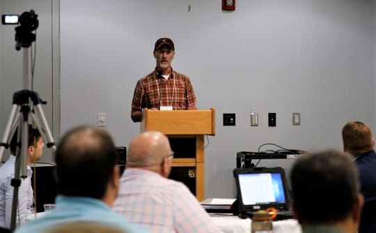 Ty Churchwell with Trout Unlimited discusses the impacts of the 416 Fire on the fishery in Durango, Colorado, Wednesday, June 19, 2019, during the Animas and San Juan Watershed Conference at San Juan College in Farmington.