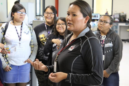Agricultural Testing Research Laboratory manager Dineh John speaks to students with the Central Consolidated School District Indigenous STEM Camp at the lab during a tour of the Navajo Agricultural Products Industry just outside Farmington on Wednesday.