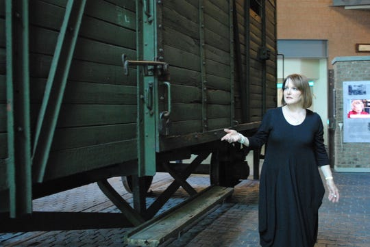 Lori Weisberg explaining the emotional weight the boxcar at the Holocaust Memorial Center, which was donated by her in-laws, holds.