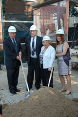 HMS docent Lori Weisberg (right) with  her in-laws Henrietta and Alvin Weisberg at a groundbreaking for the space where HMC's boxcar currently sits.