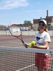 Northville tennis coach Linda Jones won three state titles and placed in the top five in the state in every year she coached the Mustangs.