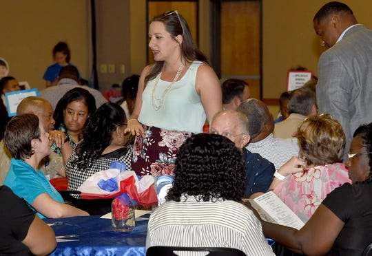 Raquella Manuel, St. Landry Chamber of Commerce CEO, talks with attendees at the CASA of St. Landry-Evangeline 10th Annual Kids Benefit Banquet.