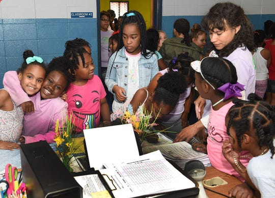 Opelousas Boys and Girls Club members sign in for their next activity on Tuesday. More than 170 children are enrolled at the club taking part in a variety of summer activities.