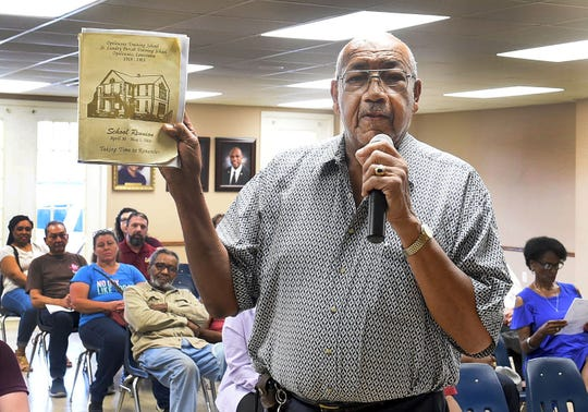 C.D. Ballard addresses Mayor Julius Alsandor and the Board of Aldermen during the recent monthly meeting to discuss plans to erect a historical memorial marker on the grounds of the old St. Landry Training School.