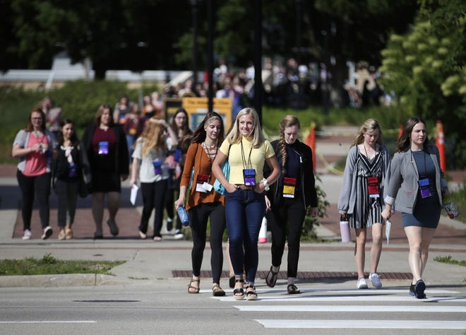 Attendees of American Legion Auxiliary Badger Girls State head to one of their afternoon sessions Monday, June 17, 2019, at the University of Wisconsin-Oshkosh.