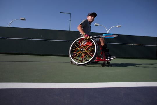 Charlie Cooper is a youth wheelchair tennis player who is Ranked No. 3 in the U.S. He is photographed at Indian Wells Tennis Garden as he practices with his coach.