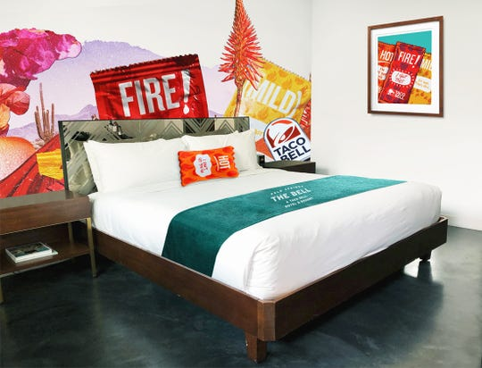 A rendering of Taco Bell-themed king room decor and amenities planned for The Bell. Reservations for the first  ever Taco Bell pop-up hotel open June 27, 2019. The Bell will take over V Palm Springs, 333 E. Palm Canyon Drive, Aug. 8-12.