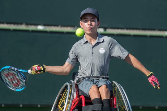 Charlie Cooper is a youth wheelchair tennis player who is Ranked No. 3 in the U.S. He is photographed at Indian Wells Tennis Gardens as he practices with his coach.