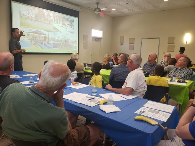 Architect Chris Giannini presents options for recreation features at the new Whitewater park during a community meeting on June 18, 2019, in Palm Springs, Calif.