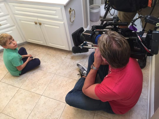 "Henry Newcamp, 7, works on home improvement projects around the house during the filming of ""House Hunters"" in Navarre in November 2018."