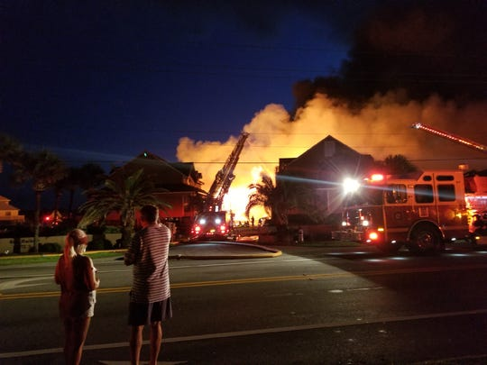 A massive fire that broke out on Perdido Key destroyed at least 26 condo units and one house early Wednesday.